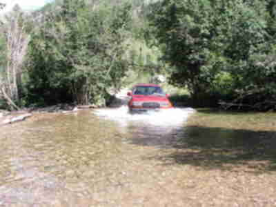 The Land Cruiser plunges into the second, deeper, stream crossing (4 of 4)