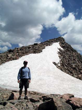 Tom at a snowfield near the last 400 feet of the climb