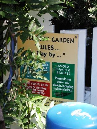 Garden Rules-covered with plexiglass and attached to fence