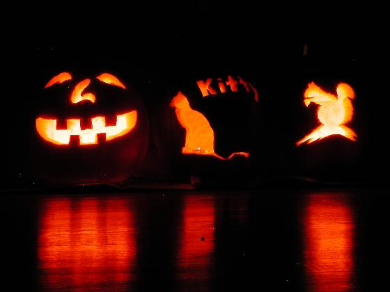 Lisa's jack-o-lantern (left), cat-o-lantern,and Brian's pumpkin