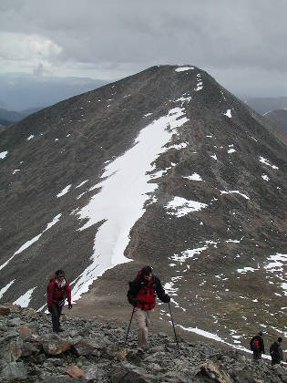 Brian and Shari approaching the Torreys summit, Grays behind