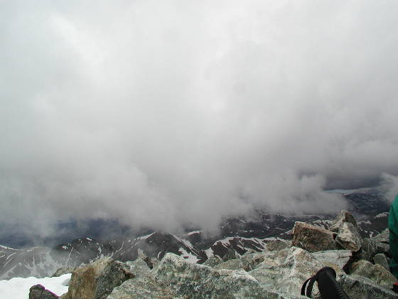 Clouds enveloping the summit, snow follows