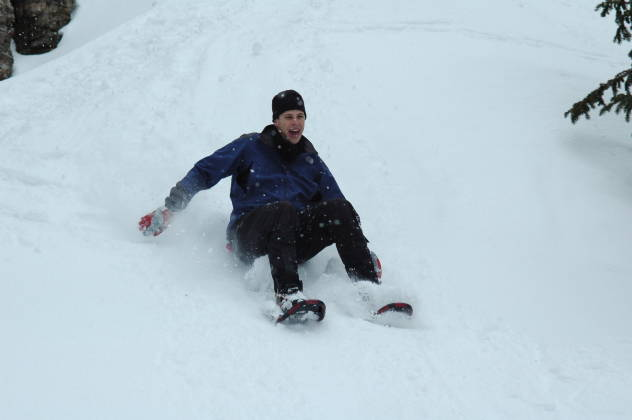 "Brian ""sledding"" down our fun hill"