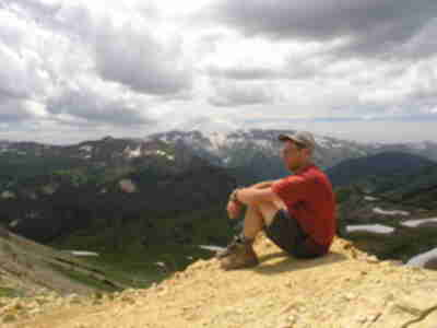 Brad relaxing atop Trail Rider Pass