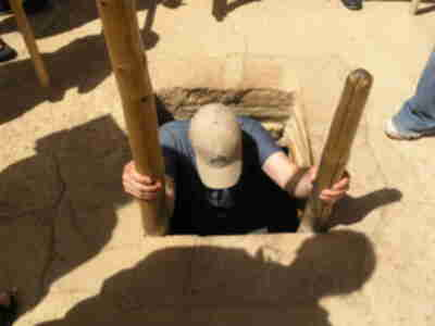 Brian emerging from the kiva
