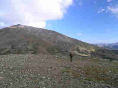 Lonny, heading northwest to the Pt. 13,630 summit