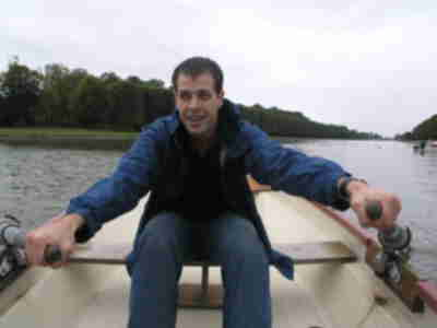 Brian, rowing a row boat on the Grand Canal in Versailles