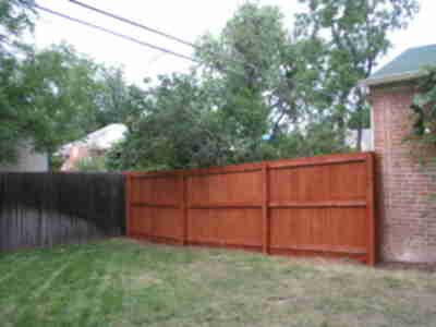 The new and stained fence