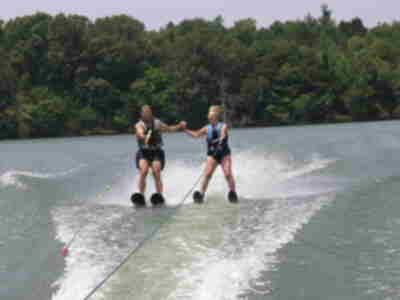 Jay and Joan waterskiing together