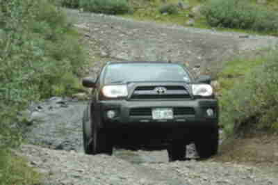 Brian, navigating the 4Runner through a stream crossing