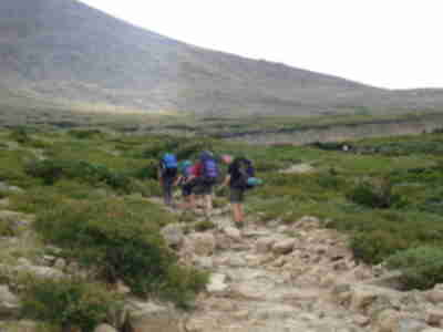 Trekking towards camp at Jims Grove (Battle Mountain)
