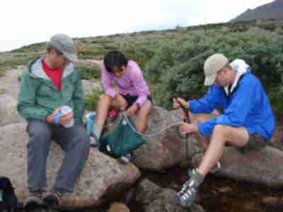 Brad, Shari, and Lonny filtering stream water