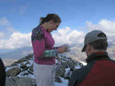 Tracy, receiving her birthday cookies on the summit