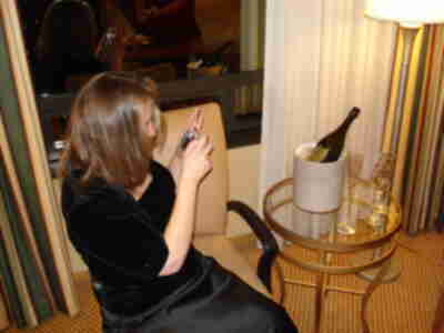 Tracy, photographing the bottle of Dom Perignon