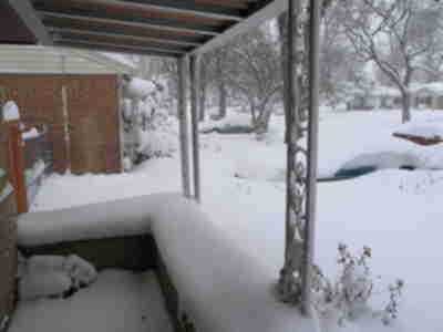 Snow piled up on our covered front porch
