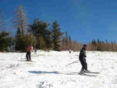 "Lisa and Lonny, skiing down ""Ferret's Hollow"""
