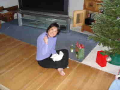 Shari, deciding that she wanted to open the gifts under the tree at the house where we stayed