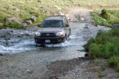 Lisa, crossing the stream in the 4Runner