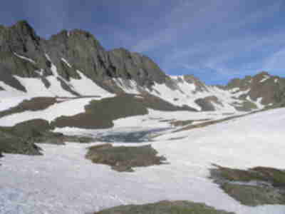 Sloan Lake, nestled in the basin at 12,900 feet and still frozen