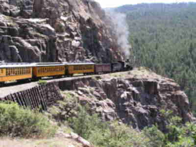 The train, rounding a corner high above the Animas river