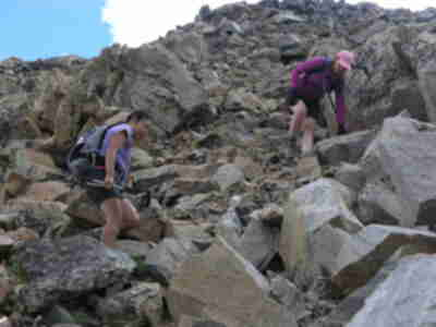 Shari and Lisa descending the talus covered slope