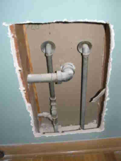 Bathroom pipes, exposed in the bedroom