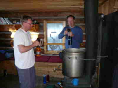 Doug and Tory pumping water