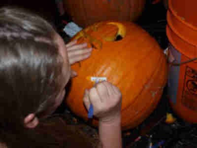 "Lisa attempts to ""shave"" the pumpkin..."