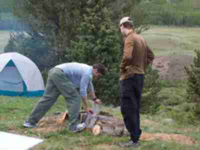 Andy and Lonny sawing firewood