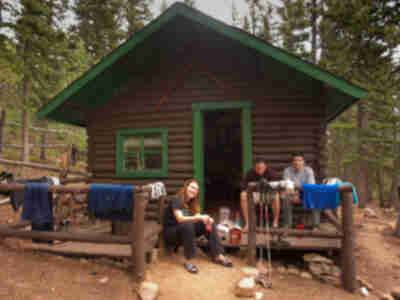 Kristy, Mike, and Andy relax in front of the upper cabin