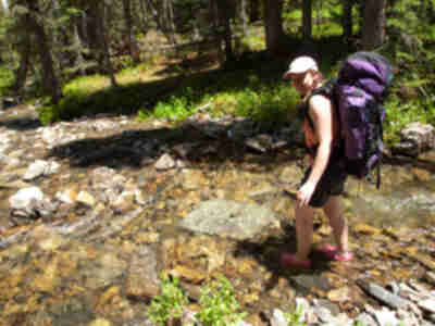 Lisa crosses a stream in Peeler Basin