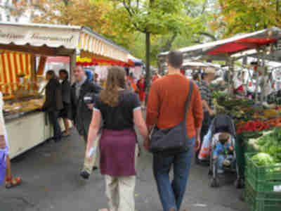 Lisa and Brian walking through the market