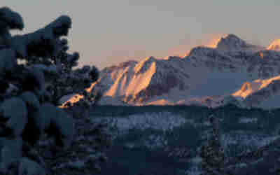 The summit of Castle Peak and the flanks of Electric Pass Peak in the glow of sunrise