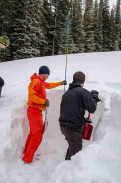 Digging a snow pit to check the avalanche danger