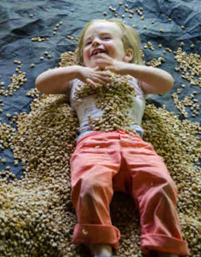 Amy plays in coffee beans