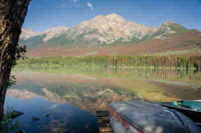 Pyramid Mountain reflecting in Pyramid Lake above the town of Jasper